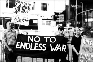 signs and banners against endless war