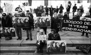 demonstrators with signs of mourning women
